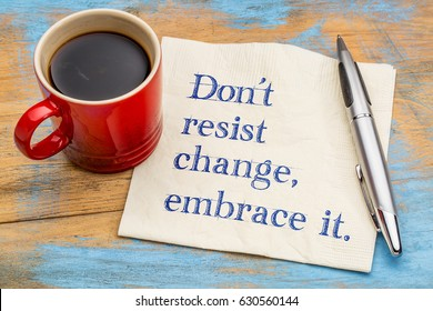 do not resist change, embrace it - motivational phrase on a napkin with a cup of coffee