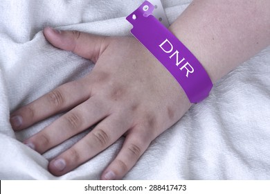 Do not resuscitate purple bracelet on a female patient in the hospital