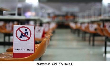 Do not sitting sign on the seat or bench at public cafeteria or canteen for social distancing  in covid19 crisis