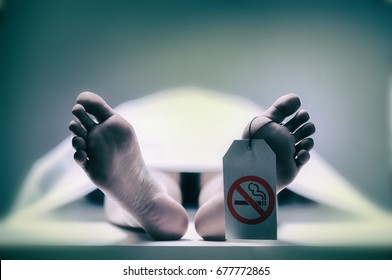 Do not smoke.Grungy photo of feet with toe tag on a morgue table