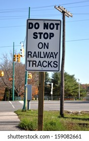 Do not stop on railway tracks sign