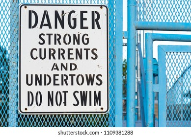 Do not swim sign warning of strong currents and undertows