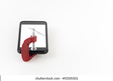 do not use the phone, black mobile phone with blank white screen locked by red clamp on white background