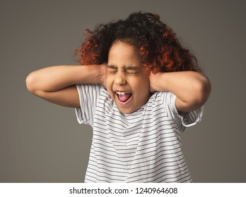 Do not want to hear or know! Kid girl covering ears with hands
