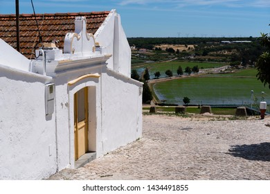 Alcácer do Sal / Portugal - June 2019: A house overlooking the landscape around the town of Alcácer do Sal in the Alentejo region. In the background are rice fields.