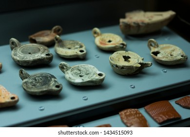 Alcácer do Sal / Portugal - June 2019: Ancient oil lamps exhibited at the Cripta Arqueológica de Alcácer do Sal Museum.