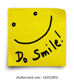Do smile with smiley face on yellow sticker paper note on white background