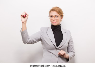 Do you know that this businesswoman dressed in a grey suit is going to mention the following tools of the trade: phone, computer, database software? You ought to start your own business.