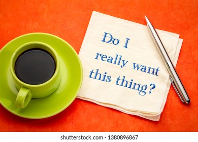 Do you really want to do this? Handwriting on a napkin with a cup of coffee.