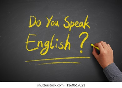 Do you speak english concept on the chalkboard with writing hand.