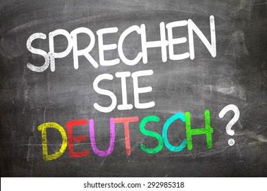 Do You Speak German? (in German) written on a chalkboard