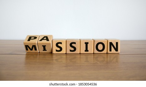 Do your mission with passion. Fliped wooden cubes and changed the inscription 'mission' to 'passion' or vice versa. Beautiful wooden table, white background, copy space.