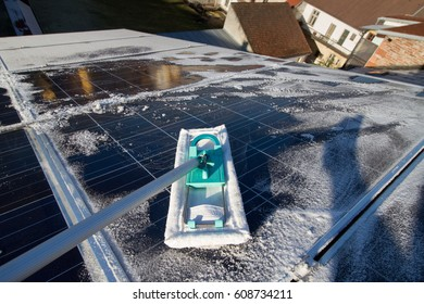 do it yourself cleaning solar panels on family house