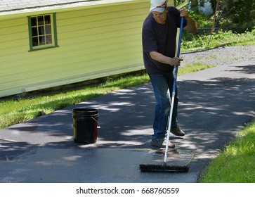Asphalt driveway images stock photos vectors shutterstock do it yourself home maintenance driveway resealing repair homeowner spreads blacktop sealant solutioingenieria Image collections