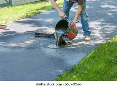 Driveway images stock photos vectors shutterstock do it yourself home maintenance driveway resealing repair homeowner pours blacktop sealant onto driveway solutioingenieria Image collections