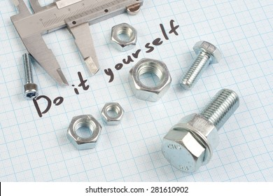 """""""Do it yourself"""" - Screw, Nuts and caliper on  graph paper background"""