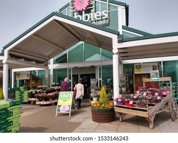 Dobbies Garden Centre, West Midlands, UK - April 18, 2019.  Main entrance to garden centre with potted plants on display.
