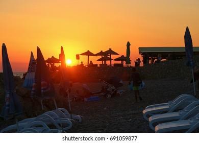 Dobra Voda, Montenegro -July 12, 2017: Beach bar on the beach of Dobra Voda in sunset light. Near Bar, Montenegro, South-East Europe.