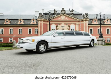 DOBRIS, CZE - MAY 20, 2016: White limousine Lincoln Town Car before Chateau Dobris