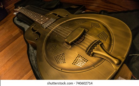 Dobro guitar in its case