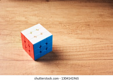 Dobrush, Belarus - 3 February 2019. Rubics cube on wooden background, top view