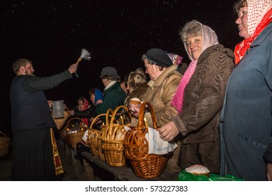 Dobrush, Belarus - May 1, 2016: The priest spends the ritual consecration of holy water on parishioners and their products at night. Easter