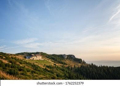 Dochia Lodge, Ceahlau Mountains, Romania during a beautiful sunrise on an autumn day