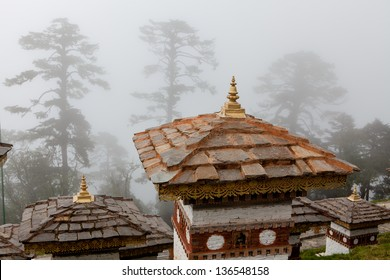 DOCHU LA,BHUTAN - SEPTEMBER 23:The rooftop of the famous monument in the misty forest at Dochu La on September 23,2012 in Dochu La,Bhutan.It is a sacred place for buthanese to pray and meditate.