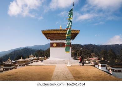 DOCHULA, BHUTAN - January 15, 2020 : Dochula pass with 108 stupas or chortens in Thimphu on the east west road.The Dochula Pass is a mountain pass in the snow covered Himalayas.