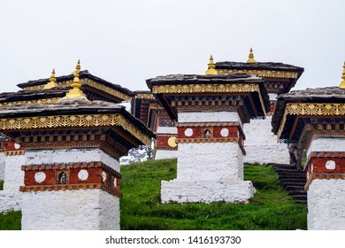 """The Dochula Pass is a mountain pass in the snow covered Himalayas within Bhutan on the road from Thimpu to Punakha where there are 108 memorial chortens or stupas known as """"Druk Wangyal Chortens""""."""