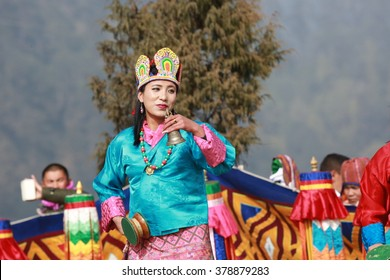 DOCHULA, THIMPHU, BHUTAN - DECEMBER 13, 2015: A dancer presents a Dakini dance with small drum, bell and a colourful hat.