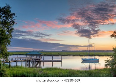Dock and Boat at Sunrise