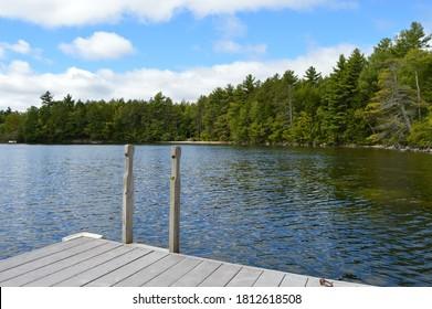 Dock at calm Lake Sunapee