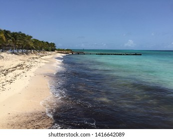 dock, crystal clear water lapping at the shore of Grand Turk