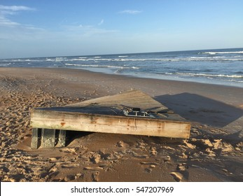 Dock debris washes up on Florida shore after Hurricane Matthew