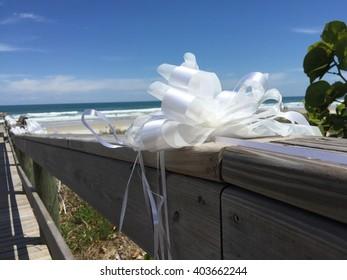 Dock leading to beach wedding