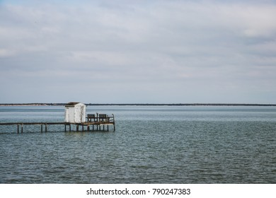 A dock leading to the ocean