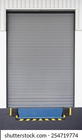 Dock leveler and shutter door, use for product transfer to truck.