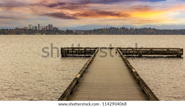 The Dock at Madrona Beach on Washington Lake in Seattle during colorful sunset.