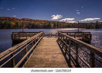 Dock on a lake during Autumn on Lake O' the Dalles at Interstate State Park.