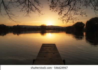 Dock on the lake at sunset near Wernigerode