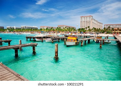 Dock on Palm Beach, Aruba on a sunny Spring afternoon