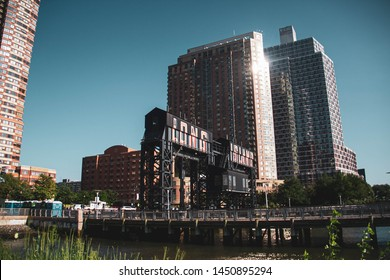 A dock over river at Gantry Plaza State Park with vintage sky, Queens, New York