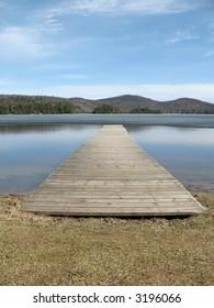 Dock points to the horizon on mountain lake