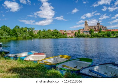 Dock of raw boats at Tormes river, in front of Salamanca of the Cathedral of Salamanc