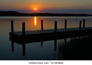 Dock at sunset, Denbigh Park Boat Ramp, Newport News, Virginia, USA.