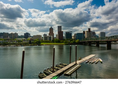 Dock in the Williamette River and the Portland skyline, seen from the Eastbank Esplanade in Portland, Oregon.
