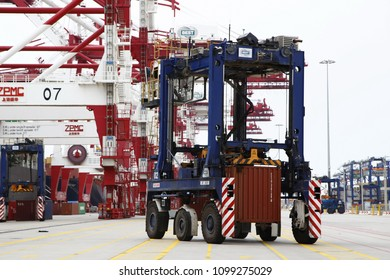 dock worker drove straddle carrier and move container on site of container terminal in BEST facility of Port of Barcelona, Spain, Aug. 23, 2014.