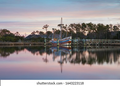 Docked boat with 2020 display in the harbor of Manteo, North Carolina marina at sunrise on the Outer Banks.