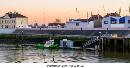 Docked boat with workers in the harbor of Blankenberge, Belgium, popular european city